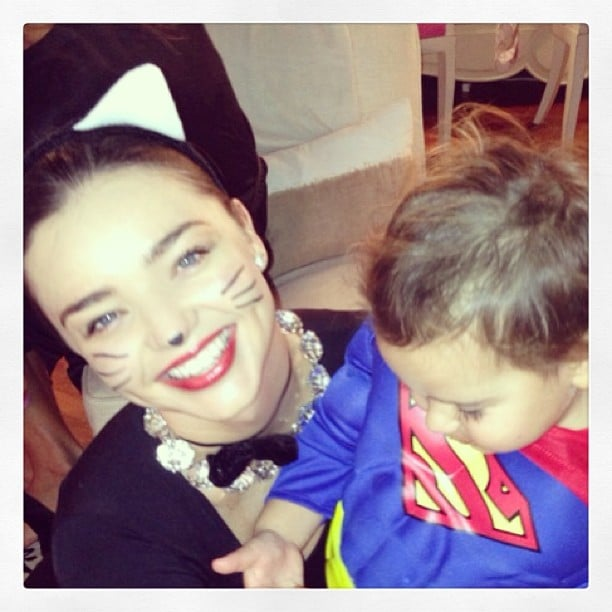 Miranda Kerr dressed as a cat while her son, Flynn Bloom, was Superman. Source: Instagram user mirandakerr