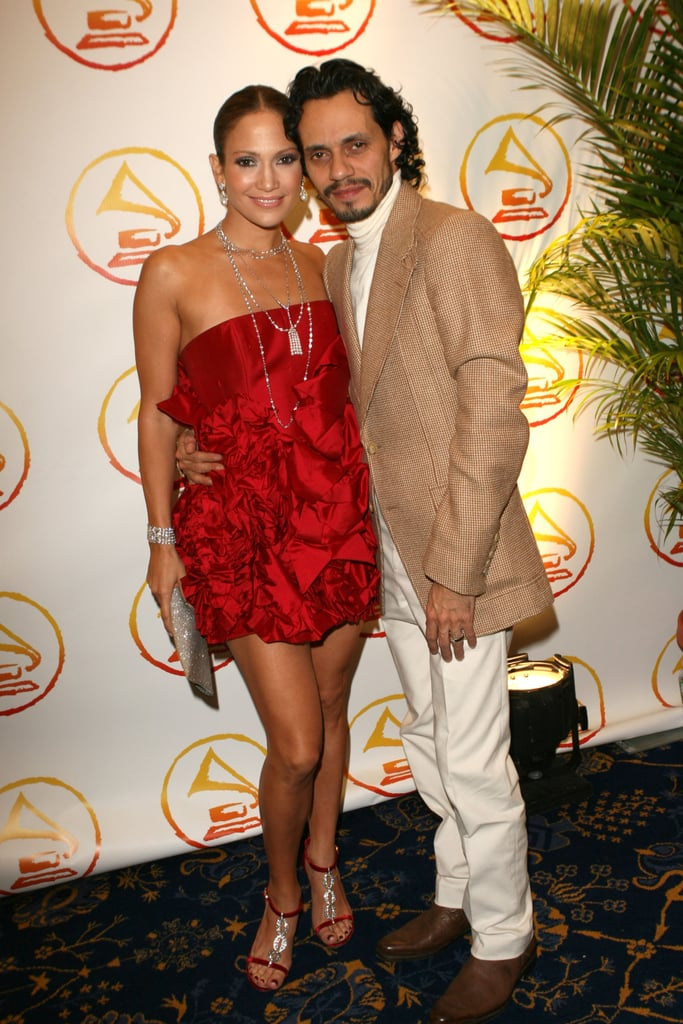 With Marc Anthony in a flirty red strapless at an event in '06.