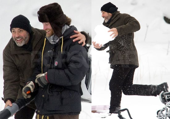 Photos of George Clooney Filming The American and Getting Into a Snowball Fight on Set in Sweden