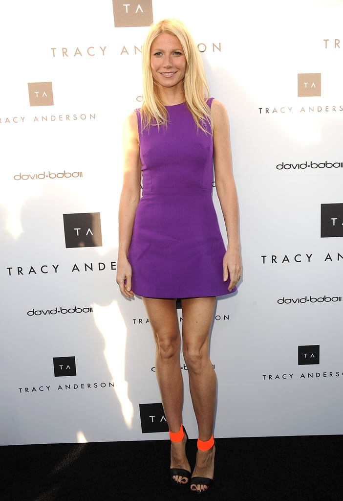 At the Tracy Anderson LA flagship opening, Gwyneth Paltrow showed off her famously toned legs in a purple Victoria Beckham minidress and colorblocked Michael Kors heels.