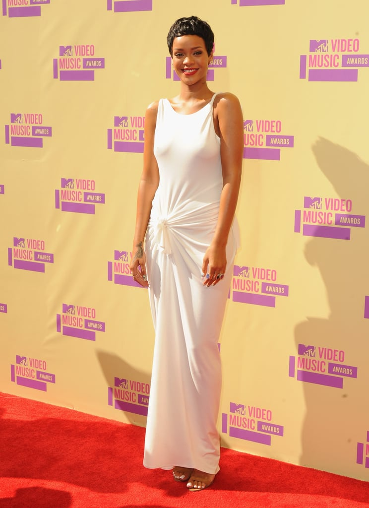 Rihanna's white backless Adam Selman gown left us breathless and was the perfect canvas for her pixie cut and red lip.