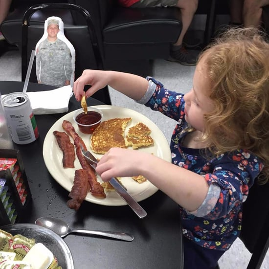 Girl Eating Breakfast With Her Daddy Doll