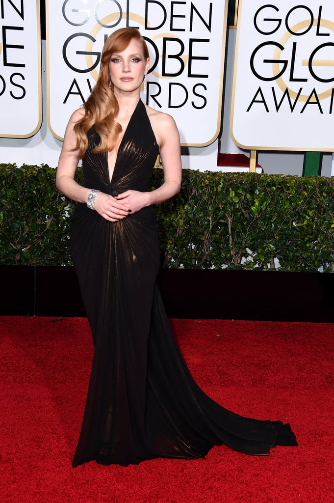 She wore an Atelier Versace dress and Piaget jewels to the 2015 Golden Globe Awards.