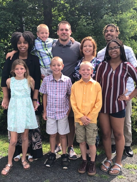 Raelyn with her husband Jarrett, her five children (Braiden, Janille, Isabella, Chase, and Ethan), and two goddaughters.
