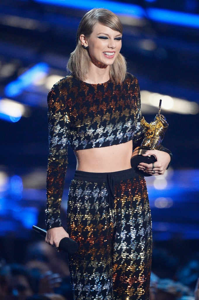 """Taylor Swift was all smiles when she hit the red carpet at the MTV Video Music Awards in LA on Sunday, and she had plenty of reasons to keep grinning throughout the night. The singer, who wore a sequined crop top and pants, was surrounded by some of her famous girlfriends on the red carpet, and she posed for pictures with pals who starred in her """"Bad Blood"""" music video.  During the show, Taylor took home multiple awards, including video of the year, best female video, and best pop video. Meanwhile, she also joined Nicki Minaj's opening performance, shared a hilarious moment with Kanye West, and debuted her new music video. Keep reading for all the best pictures of her fun night, then check out Taylor's VMAs evolution."""