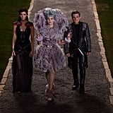 Jennifer Lawrence as Katniss, Elizabeth Banks as Effie and Josh Hutcherson as Peeta in Catching Fire.