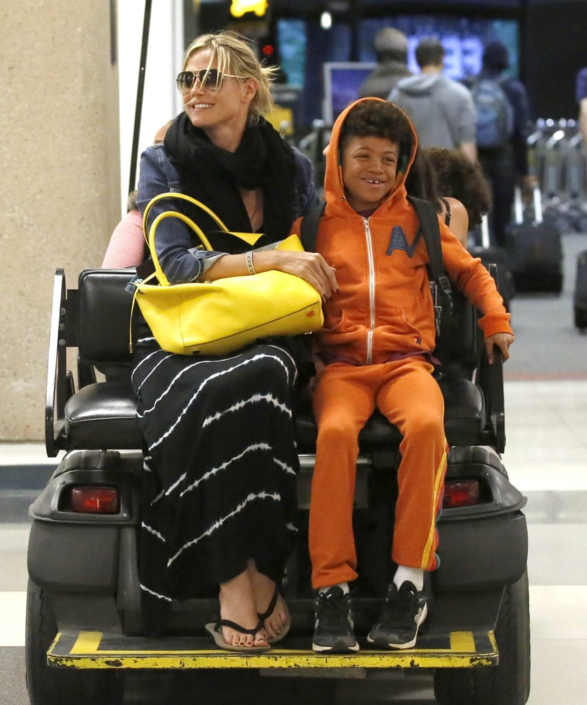 """Heidi Klum and her kids returned to LA yesterday after holidaying in Hawaii over the Easter weekend. They were all smiles at LAX and were given special VIP treatment when Heidi and her son Henry Samuel rode through the airport on the back of a buggy. Their Hawaiian getaway ended on a dramatic note when Henry and two of their nannies were swept away by a big wave on a beach in Oahu. Heidi and her boyfriend Martin Kristen were on hand to help rescue everyone, and in a statement Heidi said, """"We got pulled into the ocean by a big wave. Of course, as a mother, I was very scared for my child and everyone else in the water. Henry is a strong swimmer and was able to swim back to land. We were able to get everyone out safely."""""""