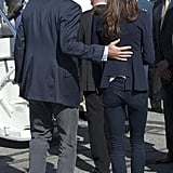 Will placed his hand on Kate's back as they made their way onto a plane at the Yellowknife airport after their Canadian tour in July 2011.