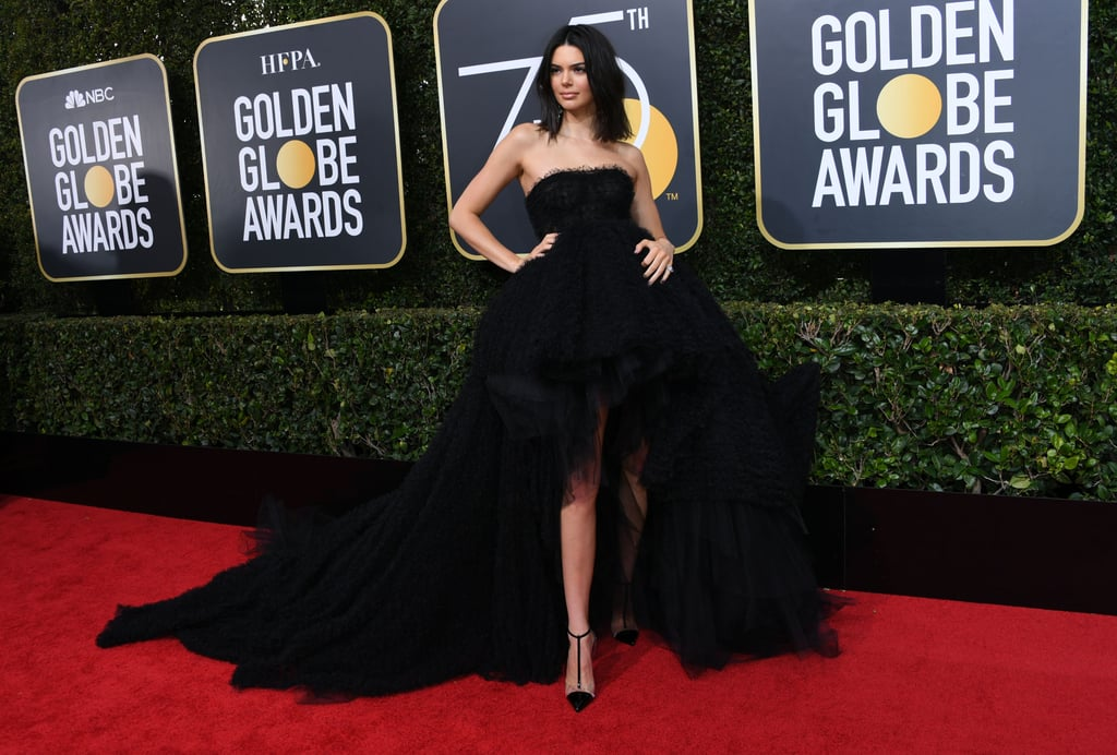 Kendall started the year off with a bang when she attended the Golden Globes wearing a black strapless gown by Giambattista Valli that featured a high-low hemline. She finished her red carpet look off with PVC heels and Lorraine Schwartz jewels, and her outfit simply took our breath away.