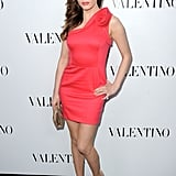 Rose McGowan embraced bold color and a minihemline in a red one-shoulder cocktail dress.