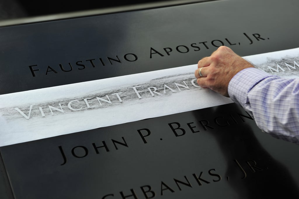 Ron Joy made a rubbing of his friend's name — firefighter Vincent Giammona — at the reflecting pool of the 9/11 Memorial in NYC.