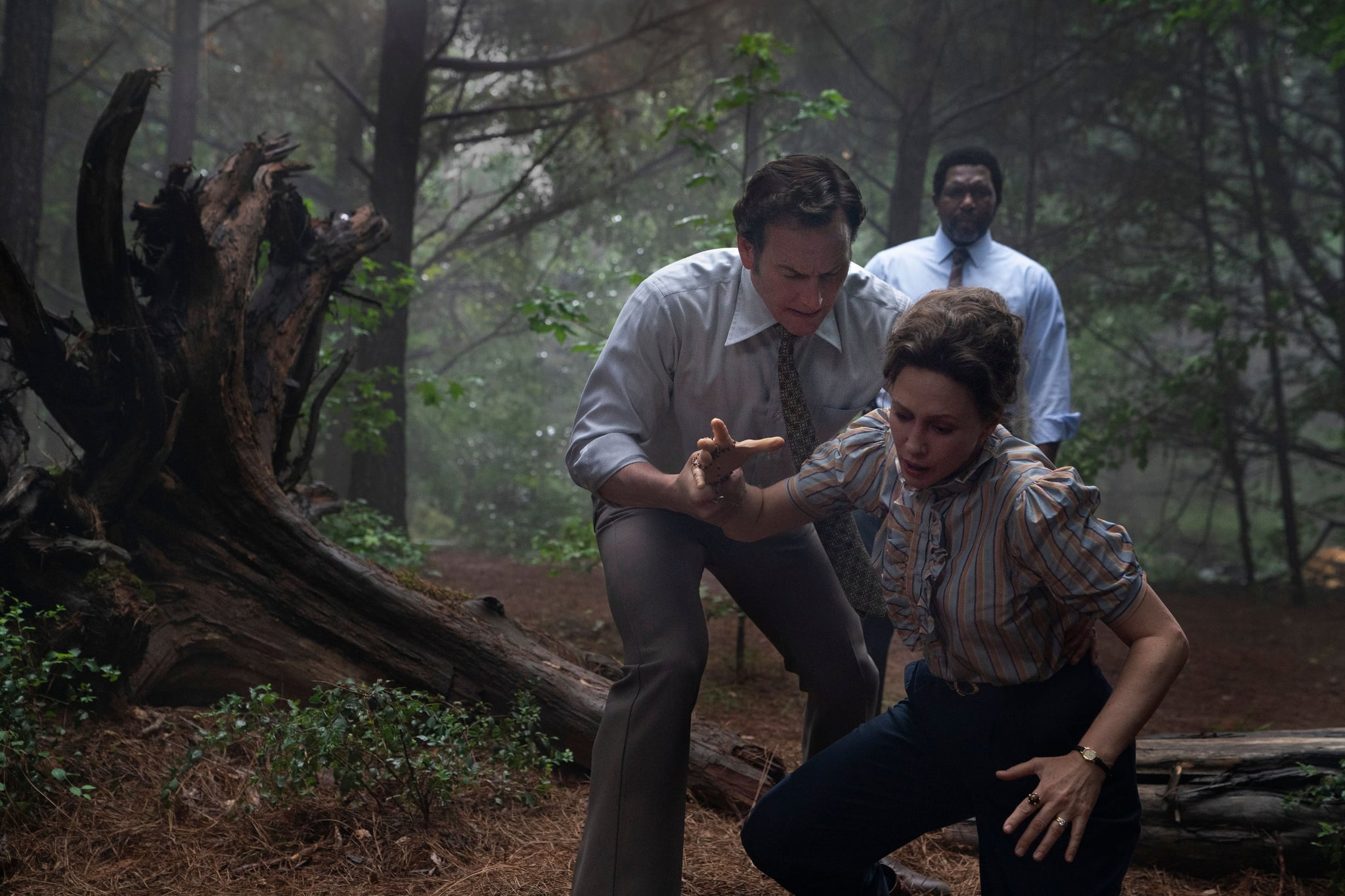 THE CONJURING: THE DEVIL MADE ME DO IT, foreground from left: Patrick Wilson, Vera Farmiga; background: Keith Arthur Bolden, 2021. ph: Ben Rothstein /  Warner Bros. / Courtesy Everett Collection
