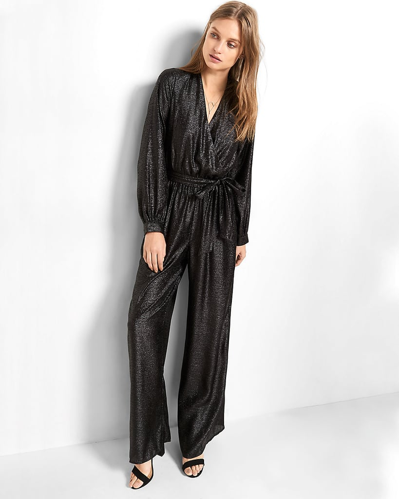"""""""I'll likely ring in the New Year at a friend's house, so while I'm looking for something fancy, I also need something that's great for lounging on the couch. This Wide Leg Surplice Jumpsuit ($108) from Express is the best of both worlds, and I truly can't wait to rock it with heels flats."""" — SS"""