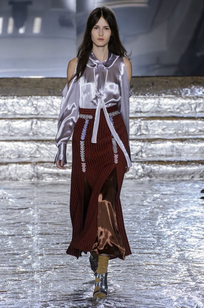 Design duo Peter Pilotto and Christopher de Vos had a case of the blues at their Fall 2016 London Fashion Week show. Inspired by the snowcapped northern landscape of Iceland, the collection was rife with icy blue, muddy brown, and soft beige and white. Ferns crawled up the front of a slinky dress that dropped off one shoulder, abstract designs were emblazoned across the chest of multicoloured tops, and jagged icy prints covered coats and dresses. There was a lot to covet here, from the soft silk dresses to the cozy peach and silver coats. And if the clothes are a little out of reach, take note that the designers have teamed up with Atelier Swarovski to create a range of jewellery that mimicked the icy branches that appeared on the clothes. Fans of the brand will no doubt love this opportunity to wear even more of the duo's unique creations.