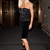 Donatella played hostess in an embellished Versace bustier and body-con pencil skirt.