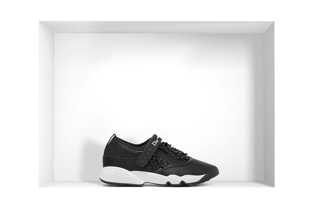 The shoe of choice was the Black Nappa Fusion Sneaker, which is only available at boutiques and retails for around $930, but you can shop similar options for yourself ahead!