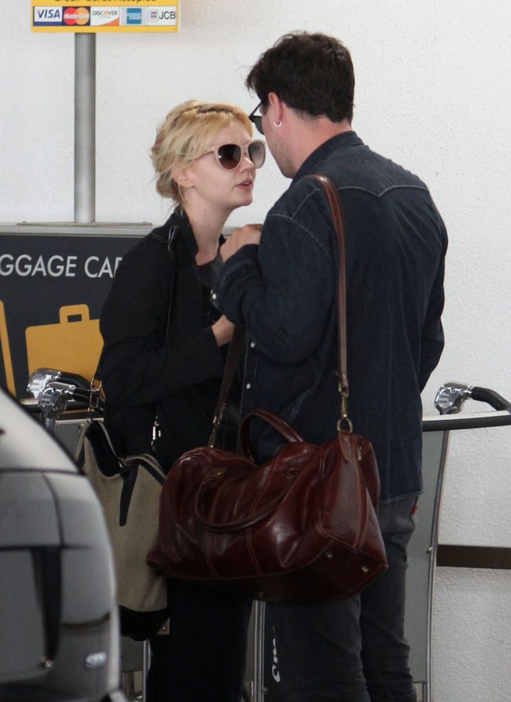Carey Mulligan and Marcus Mumford touched down at LAX together yesterday. The married duo stayed side by side as they exited the terminal and waited for their ride to arrive. Marcus and his band, Mumford and Sons, have had a busy Summer touring, and Carey's been able to accompany him to many of their gigs. She's also got her own big-screen career to focus on, though the opening of her next release, The Great Gatsby, was delayed until January 2013. Carey will star in Nancy and Danny, a black comedy, next. There are also rumors about another project — according to reports,Carey might be pregnant.