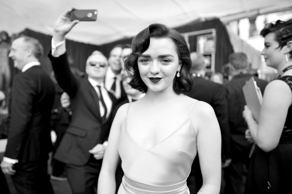 The cast of Game of Thrones has a history of slaying at award shows, which they continued on Sunday night in LA. The Screen Actors Guild Awards red carpet was host to fierce poses from leading ladies Gwendoline Christie and Maisie Williams, as well as some charming smiles from Michiel Huisman and Alfie Allen. Here's hoping the incredibly friendly cast will get together for one of their annual group photos!