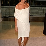 Donna Karan revealed a bit of cleavage in a white off-the-shoulder dress and black lace-up sandals.