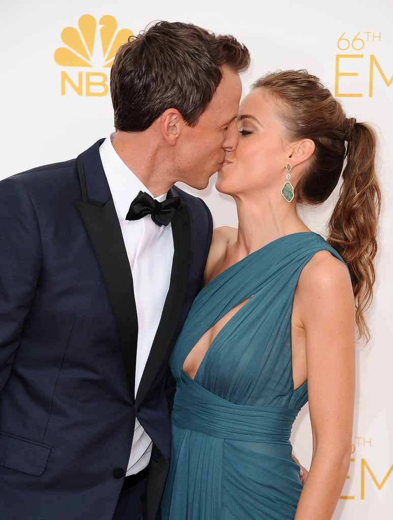 Seth Meyers planted a kiss on his wife, Alexi.