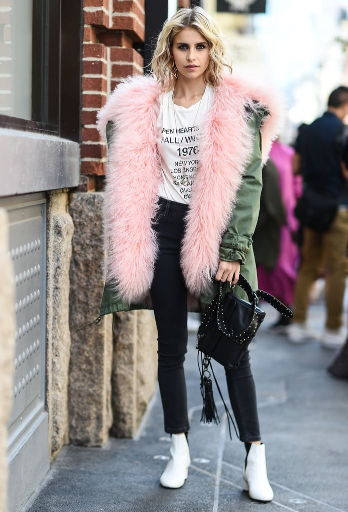 Black jeans provide a good base for you to go a little more over the top in other areas, like with a furry pink and green coat. Make a statement with one item, and let the rest of your outfit be more plain.