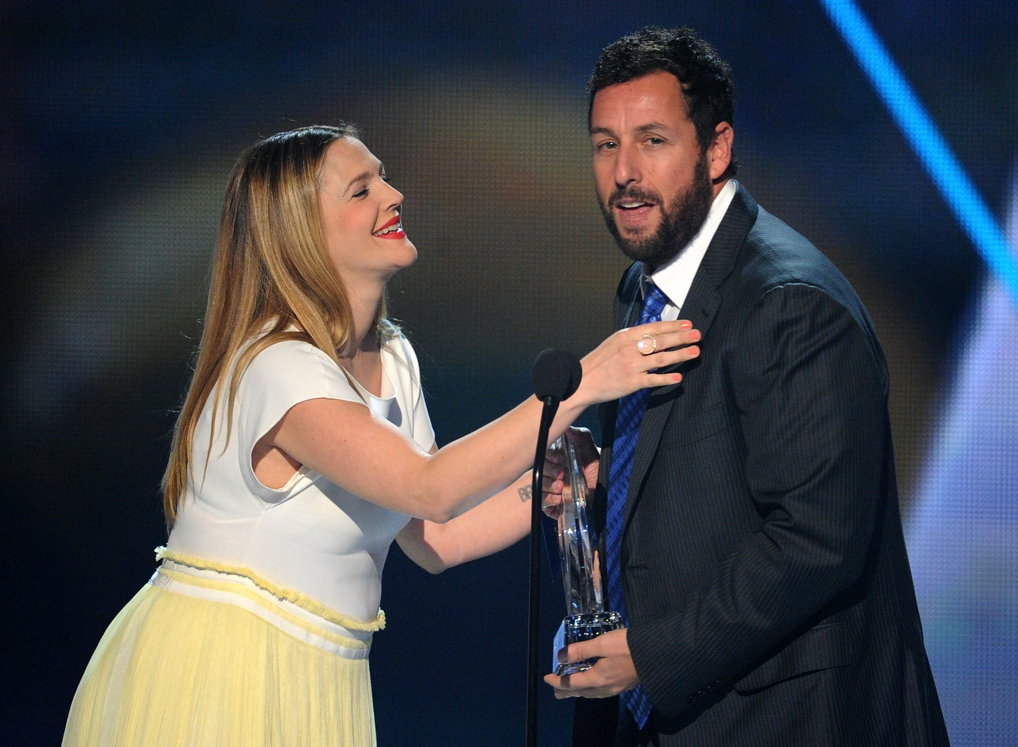 Drew Barrymore joked with Adam Sandler when she presented him with his award.