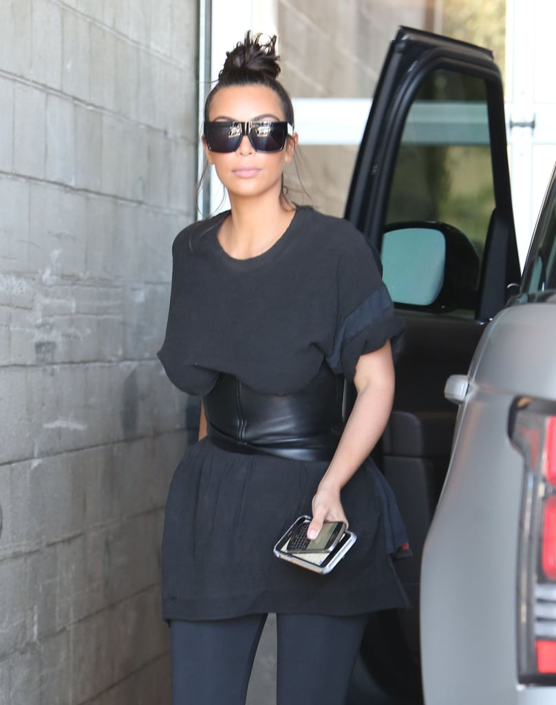 """After famously leaking husband Kanye West's phone call with Taylor Swift over the weekend, Kim Kardashian was spotted at Milk Studios in LA with sister Khloé on Tuesday afternoon. The mother of two — who was there to film a segment for Keeping Up With the Kardashians — appeared serious in all black, while Khloé flashed a sweet smile as she made her way into the studio. Since Kim shared the incriminating footage of Taylor on Snapchat, several stars — including Selena Gomez, Katy Perry, and Chloë Grace Moretz — have taken to social media to voice their opinions on the matter. In fact, Chloë, who's already had a tumultuous history with the Kardashian family, called Kim and Taylor's feud """"petulant and unimportant,"""" to which Khloé quickly responded with a post that included a graphic photo of a girl in a bikini, which she presumably thought was Chloë. Keep reading to see more of the ladies' outing, then get all the details on Kanye and Taylor's feud."""