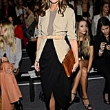 We spotted the style setter working a simple draped maxi skirt and a khaki blazer, cinched at the waist and finished with a pair of sexy albeit minimalist ankle-strap heels, in Rachel Zoe's front row.
