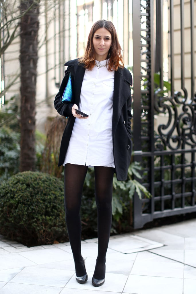 This showgoer revived a classic white button-down with tights, pumps, and a slick clutch.