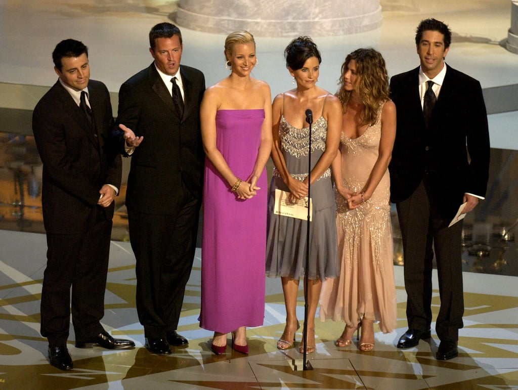 The cast presented an award on stage at the Emmys in 2002.