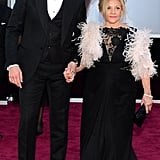 Bradley Cooper held his mom Gloria's hand while walking the Oscars red carpet on Sunday in LA.