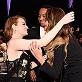 Pictured: John Legend, Emma Stone, and Chrissy Teigen