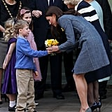 She greeted a young boy during a visit to Piccadilly Circus in March 2012.
