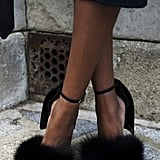 Alexander Wang heels added a furry touch to a chic ensemble.