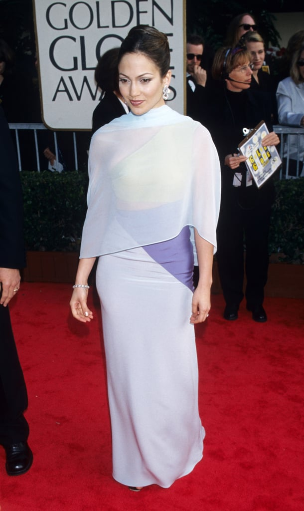 Trying out a sheer cape at the Golden Globes in '98.