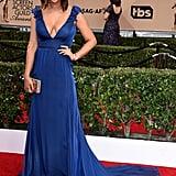 Jackie Cruz glamorous in a cobalt blue dress.