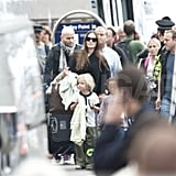 Angelina Jolie wears a black cape in Glasgow with daughters Shiloh Jolie-Pitt and Zahara Jolie-Pitt.