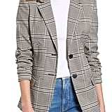 Or if you're looking for something more timeless and sophisticated, you can never go wrong with a suit consisting of a neutral plaid blazer ($109) and trousers ($89).