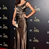 At the Sydney Opera House, Miranda posed in a draped Collette Dinnigan gown, emerald earrings, and an embellished clutch.