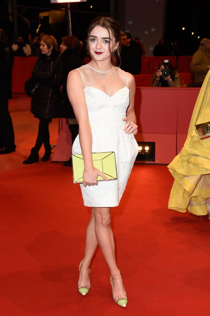 A white Fitriani dress gets a dash of Maisie's signature style with the addition of bright yellow accessories.