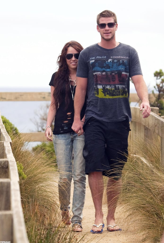 Miley Cyrus and Liam Hemsworth were hand in hand on the beach in Australia in January 2010.
