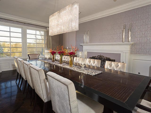 Statement lighting fixtures, like this rectangular glass chandelier in the dining room, give a nod to the midcentury decor of Dorothy Draper while aligning with Jennifer's personal style.