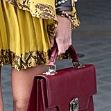 A scholarly satchel juxtaposed an armful of cool bangles and yellow ruffles.