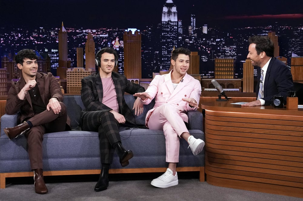 "The Jonas Brothers stopped by The Tonight Show Starring Jimmy Fallon on Wednesday and played a game of ""Know Your Bro."" Each brother took turns wearing a pair of headphones that canceled out any noise, while the other two answered a question about whoever couldn't hear. And it seems like they're really sticking to being completely open and honest about their lives and brotherly relationship (which they pledged to do in their new documentary).  The game ended up revealing nuggets of information about each sibling that even the biggest Jonas Brothers fan might not know, including the details of Kevin's bad-boy phase and Joe's hilariously wild bachelor party. ""I'm trying to see if I remember . . . anything,"" Joe said about his big bash before describing just how crazy things got. Unsurprisingly, when it was Nick's turn, he threw in a little humble brag, invoking eyes-rolls and sarcastic reactions from Kevin and Joe. Gotta love the sibling shade! Ahead, watch them play the game before jamming out to their live performance of ""Only Human"" from their latest album, Chasing Happiness.       Related:                                                                                                           20 Songs the Jonas Brothers NEED to Perform During Their Happiness Begins Tour"