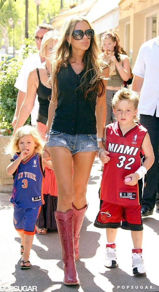 Victoria Beckham ran errands with Romeo and Brooklyn in August 2004 while on vacation in Saint-Tropez.