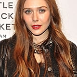 While attending Chanel's The Little Black Jacket dinner in Milan, Elizabeth Olsen wore her leather jacket with reddish-tinged hair, bright red lips, and glowing skin.