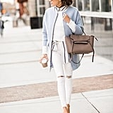 With a White Sweater Layered Over a Striped Button-Down, a Blue Jacket, and Beige Heels