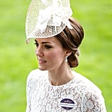 For Kate's first day at Ascot, she teamed her white lace Dolce & Gabbana dress with pearl drops, set with an aquamarine and diamonds. They are believed to be from Robinson Pelham, who designed her wedding earrings.
