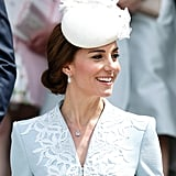 For a Service of Thanksgiving to commemorate the queen's 90th birthday, Kate paired earrings that she had worn before with a new cushion-cut aquamarine and diamond pendant.