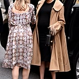 Meghan Markle Fall Outfit Idea: A Black Dress, with a Beige Trench, and Cow Print Heels